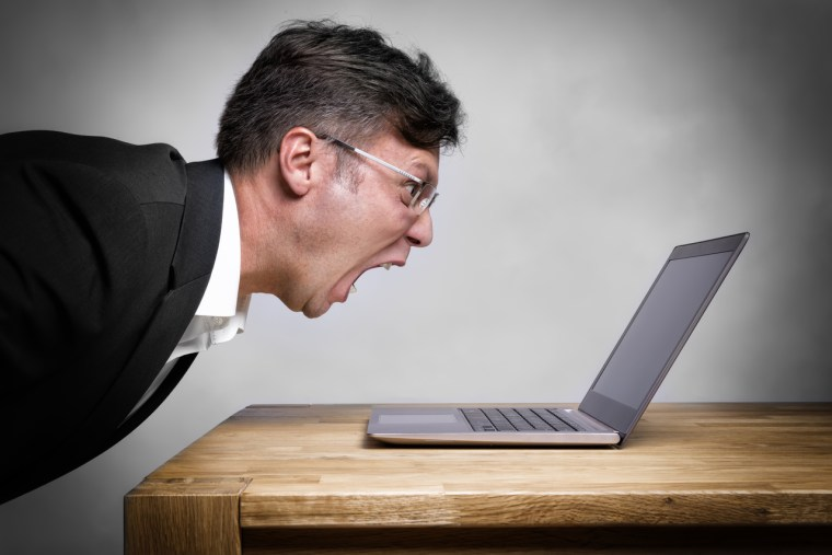 Man yelling at laptop