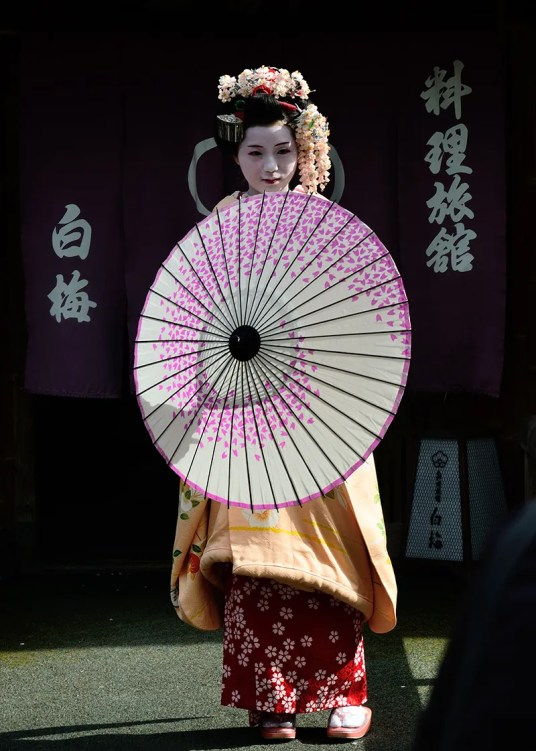 A Giesha on the streets of Kyoto, Japan