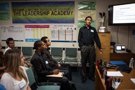 Terrick Bakhit introduces himself in a sales job training in San Diego, California, September 24, 2014. Bakhit has completed his GED, but never held a job, despite looking for one for the past three years. Bakhit is a former foster child who's struggled to make his way as an adult. He spent his 18th birthday incarcerated after a three-minute joyride in his group home van, so is unable to take advantage of AB12 – California legislation that gives assistance to foster youth as they transition into adulthood. Photo by Max Whittaker.