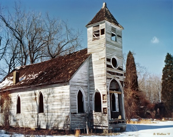 picture of an abandoned church building that is falling apart, perhaps what some would call a dead church