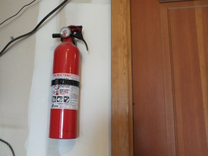 Wall mounted fire extinguisher