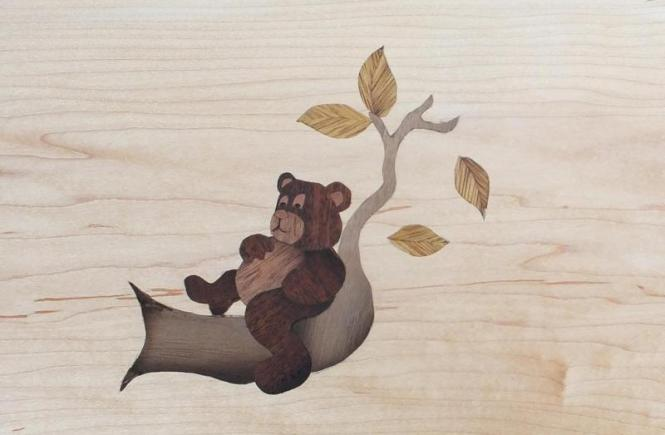 Wood inlay of a bear