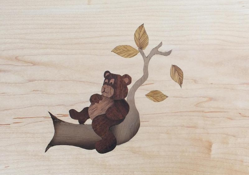 Wood inlay of a bear