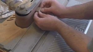 Sanding small parts with a belt sander
