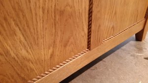 quarter round rope molding installed around bench panels