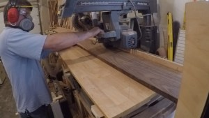 cutting wood at the radial arm saw