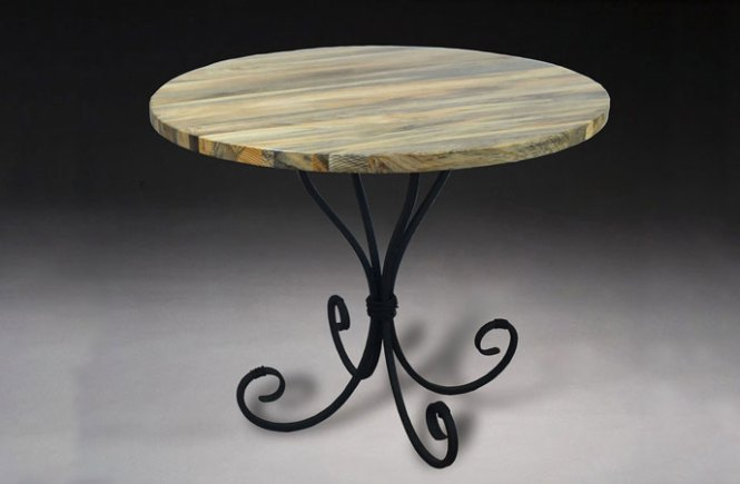round table with hand built steel furniture for legs