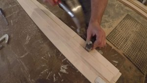 Cleaning up the corner of a mortise using a corner chisel