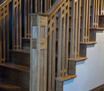 Custom built and designed hickory staircase and handrail by Benham Design Concepts