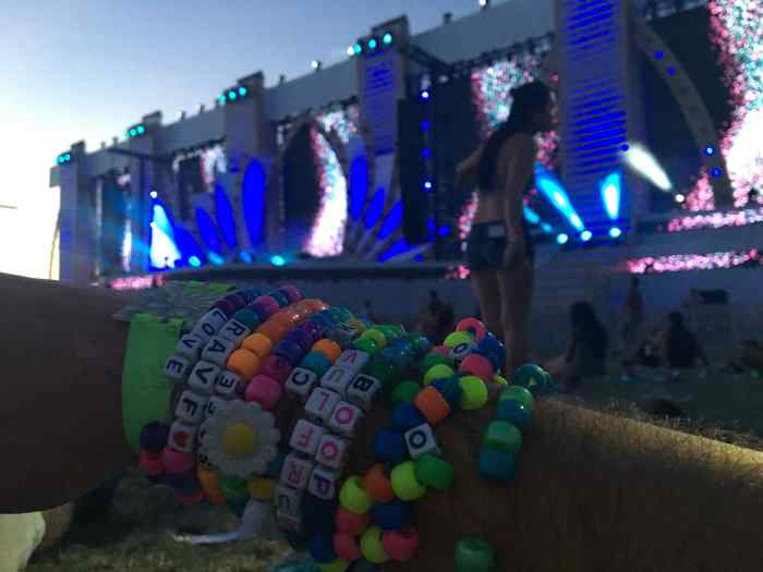 Sunrise listening to Tycho while laying in the grass at Cosmic Meadow. The Kandi are all from exchanges with different people I had met.