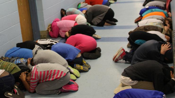 students during a tornado drill in school
