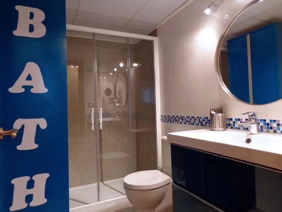 reforma baño turquesa