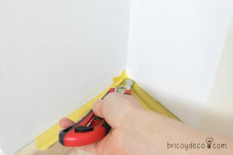 proteger las esquinas con cinta de enmascarar para pintar