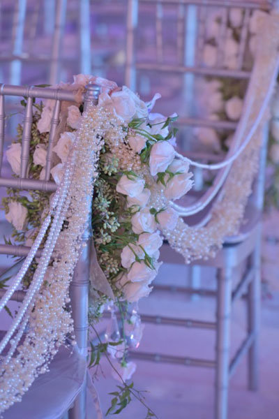 pearl stands ceremony aisle decor