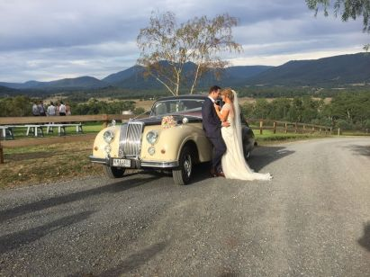married with classic wedding car