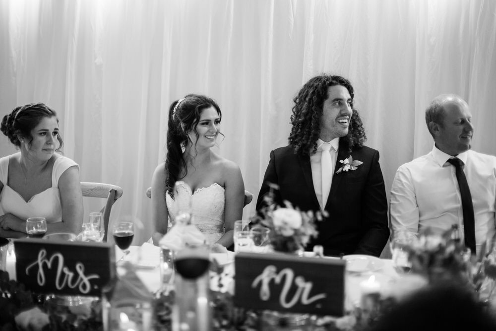 bridal party react during ceremony