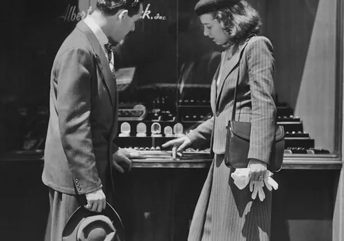 vintage image of couple window shopping for rings