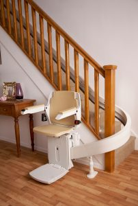 Acorn-Curved-Stairlift-at-bottom-of-staircase (3)