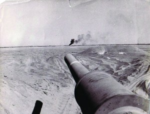 This picture shows the strength of one tank, that could hit a target from more than a kilometer away. In the picture you can see my tank cannon, and the black smoke in the background is the target we hit.