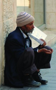 8 July 2014 a beggar in Jerusalem's Jaffa Street, near Zion Square. Usually in the middle of the day the precinct is bustling with visitors, but with warnings of possible missiles from Gaza, most locals and visitors stay away. (248J3)