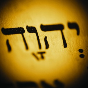 JHWH - a hebrew tetragram for the name of Jewish and Christian God. Sepia toned monochrome, low DOF.