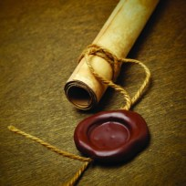 Manuscript with wax seal on a wooden table