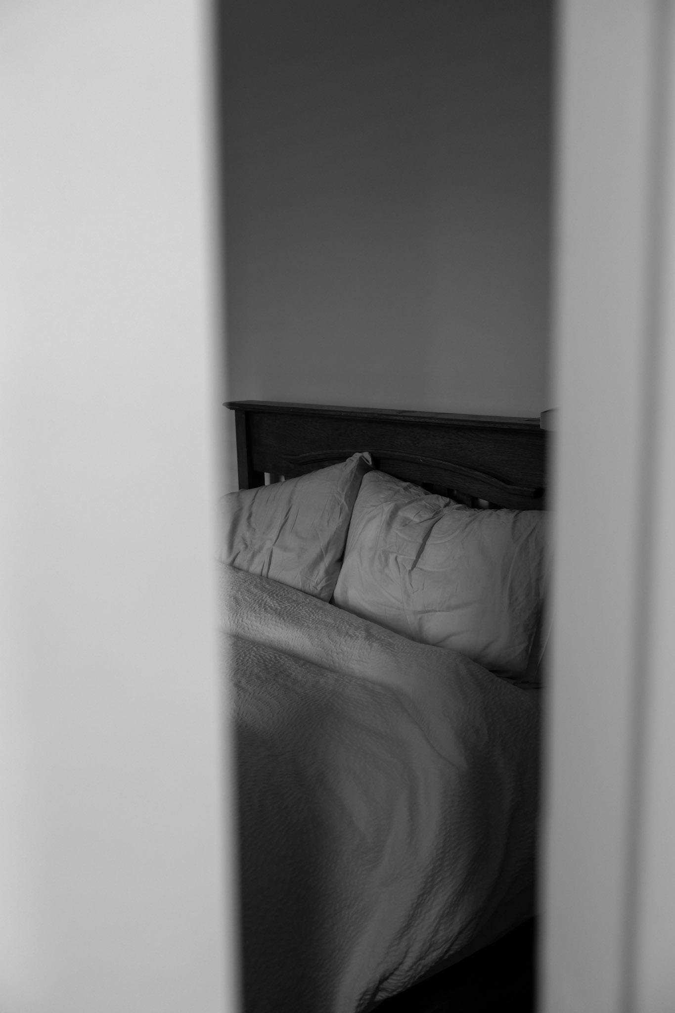 Bedroom, sleeve drama, morning light, white cotton sheets through doorway
