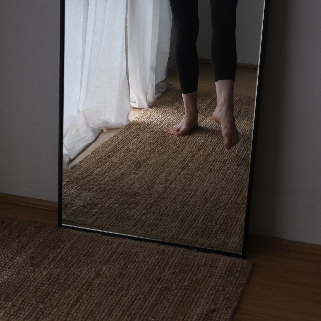Image of pointed feet in mirror. Sustainable activewear review, sustainable brands, minimalist fashion, minimal wardrobe, capsule wardrobe.