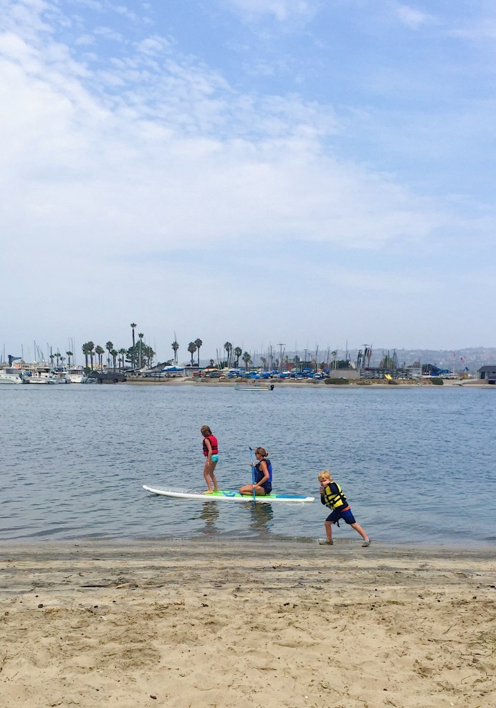 Kids Paddleboarding in Mission Beach