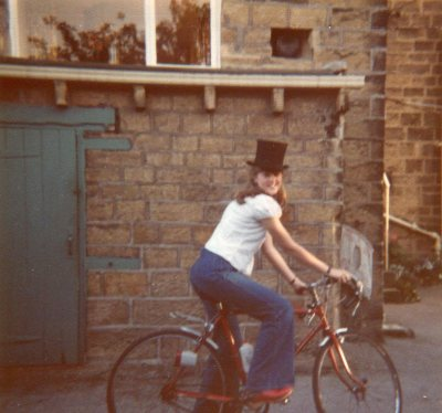 Helen on her bike with uncle Arthur's top hat 1976