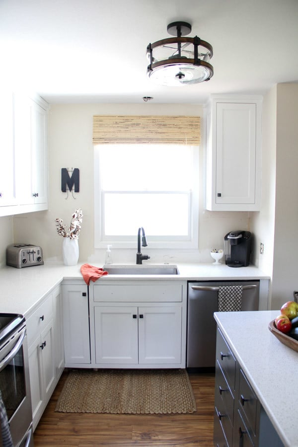 kitchen on a budget magician remodel modern two tone painted cabinets 10