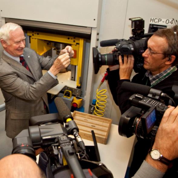 OTTAWA, Dec. 6, 2011 - The Royal Canadian Mint was honoured today to host His Excellency the Right Honourable David Johnston, Governor General of Canada to strike a Queen Elizabeth II Diamond Jubilee Medal, marking the 60th anniversary of Her Majesty's accession to the throne in 1952. Photo by Jeff Radbourne.