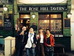 The Rose Hill Tavern with campaigners outside, including Caroline Lucas