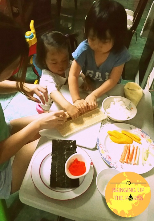 My sister teaching the kids how to make California Maki