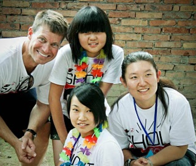 Jeff Knipe With Fangfang Above Wenwen Below And Translator At Camp In Xian