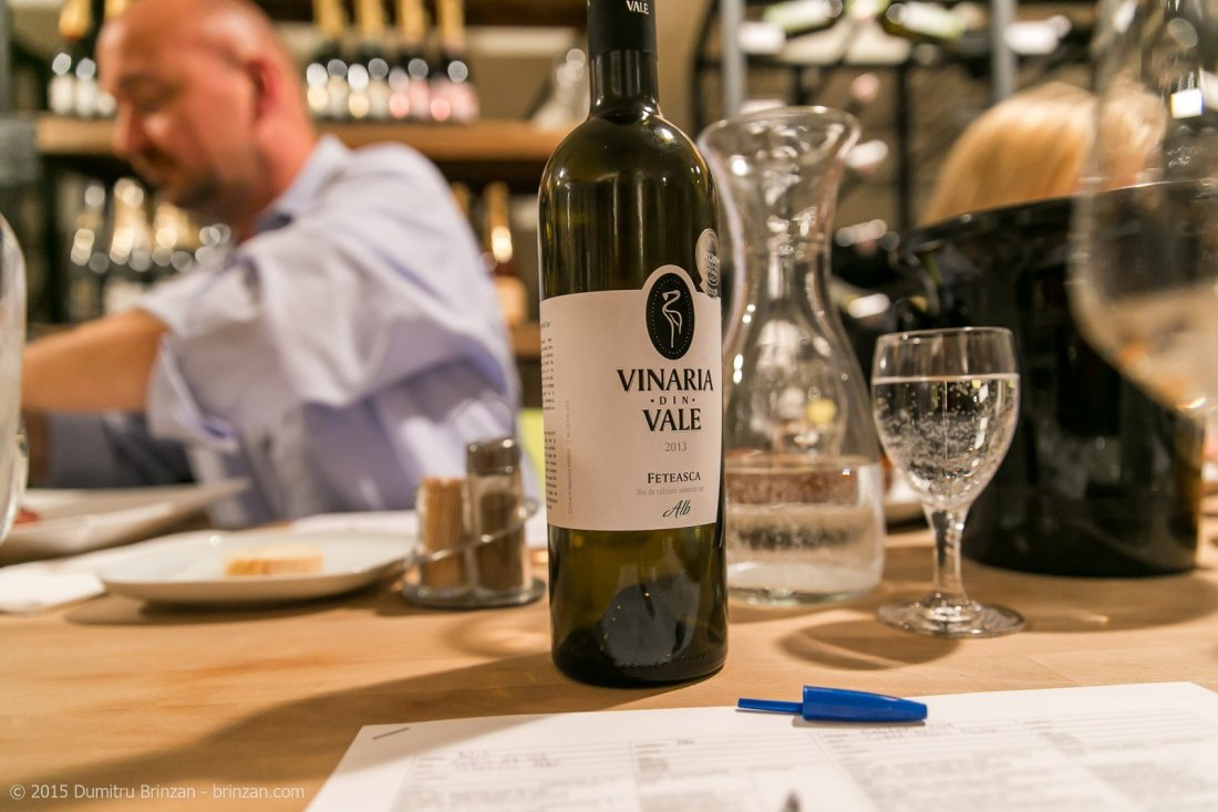 A bottle of Vinaria din Vale Feteasca Alba 2013 on a Table