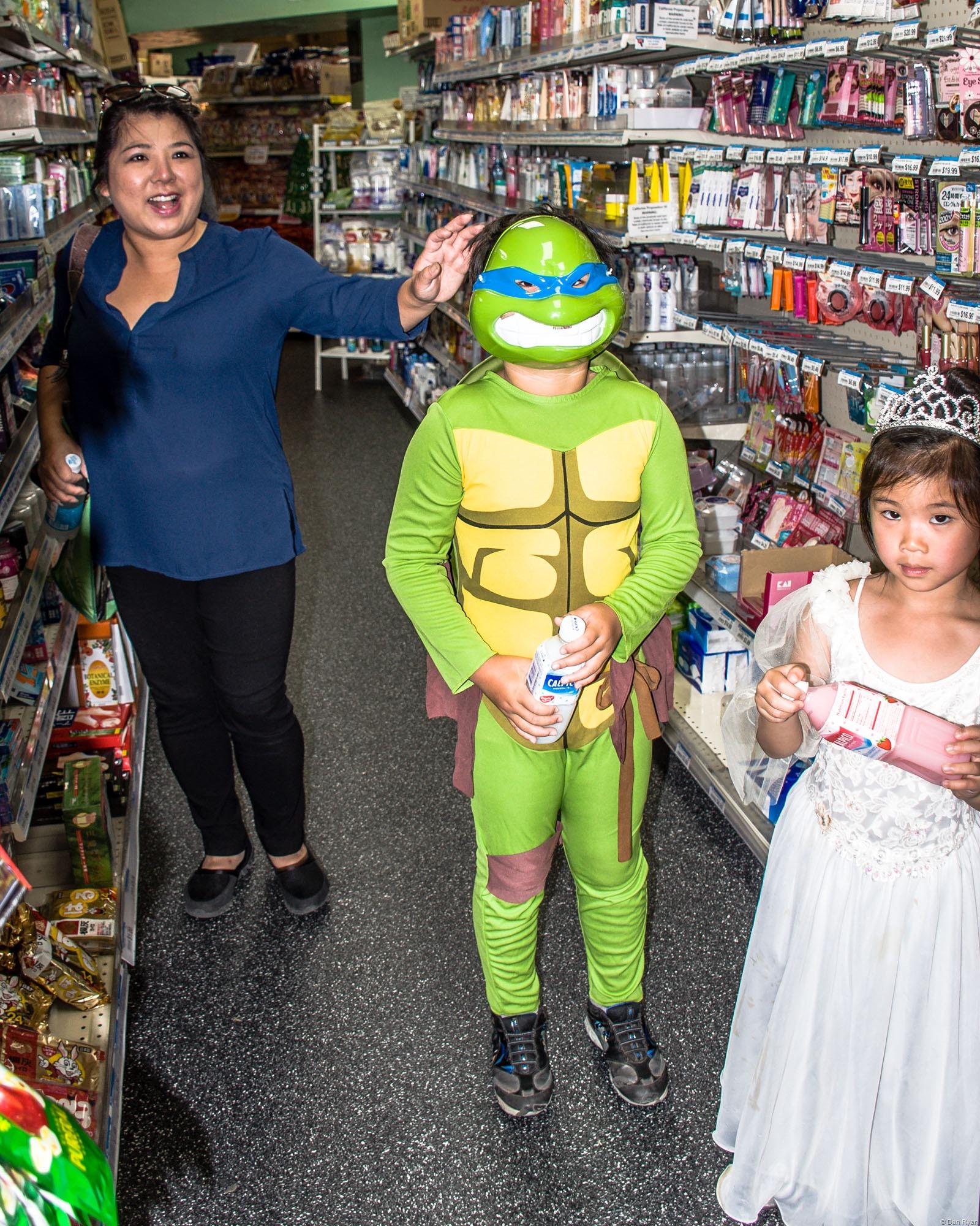 Teenage mutant ninja turtle kid and mom and sister