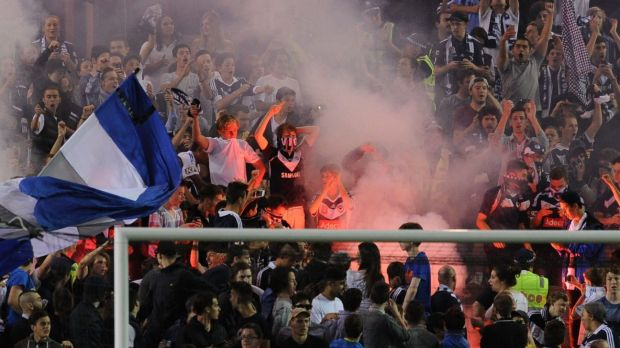 Feeling the heat: Melbourne Victory fans let off flares at Friday nights A-League match against Brisbane Roar.