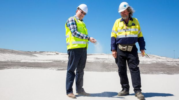 Brisbane's New Parallel Runway project director Paul Coughlan (left) with works inspector Des Hasemann on top of 11 ...