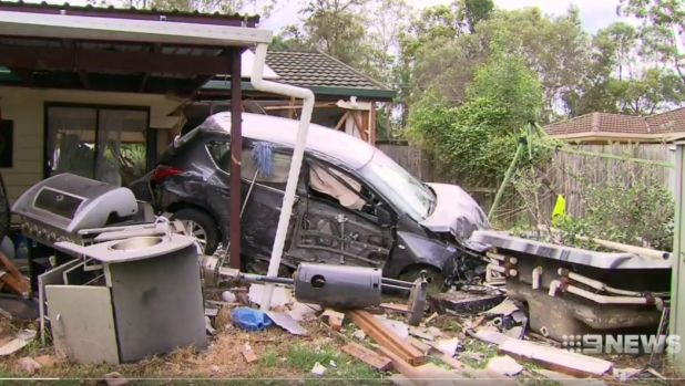 A car smashed through the porch of a home at Ipswich.