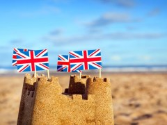 british flags sand castle beach