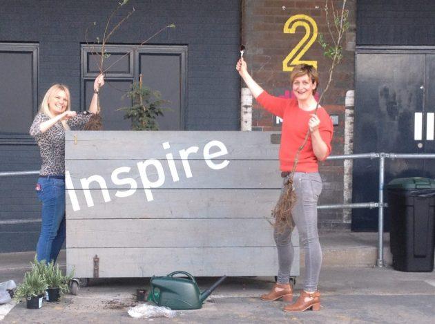 HAB staff outside studio planting seeds