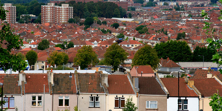 View of housing rooftops and flats over Bristol.