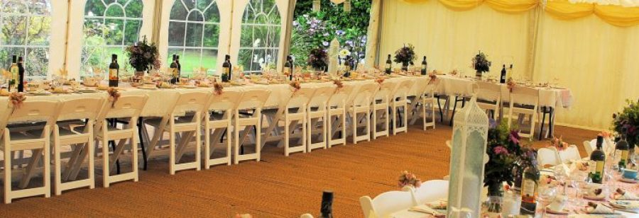 Vintage wedding with white folding chairs