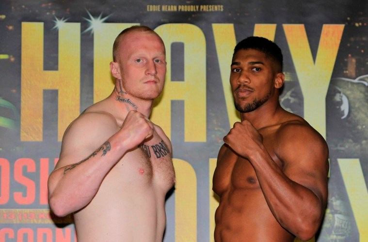 HEAVY DUTY WEIGH IN REEBOK CLUB,LONDON PIC;LAWRENCE LUSTIG COMMONWEALTH AND WBC INTERNATIONAL HEAVYWEIGHT TITLE ANTHONY JOSHUA AND GARY CORNISH WEIGH IN