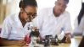 School students using a microscope