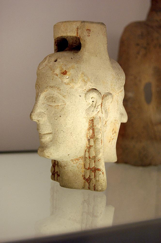 Terracotta aryballos (oil-bottle) in the form of two heads, one male, one female. An imitation of an East Greek type.
