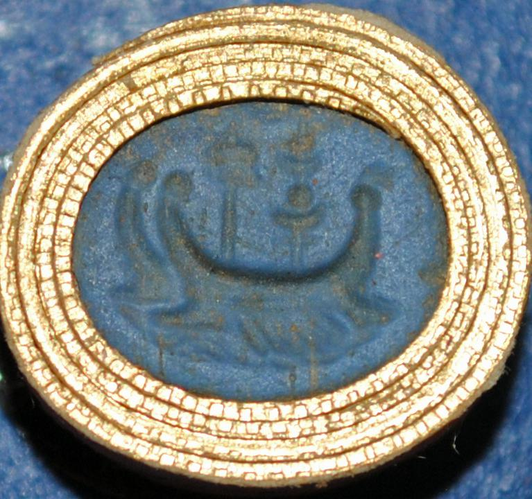 Oval pale blue glass paste intaglio: two oared ships with a bird and an incense-burner on board.