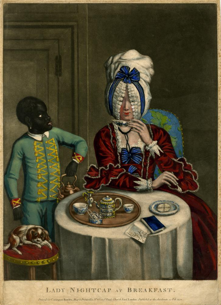 A fashionably-dressed woman in a bonnet with a lace fringe that covers her eyes, taking breakfast at a round table set with a tray of tea things, a biscuit on a plate and a small book; a black page bringing a kettle on the left and a spaniel on a chair by the table.  1772  Hand-coloured mezzotint with some etching