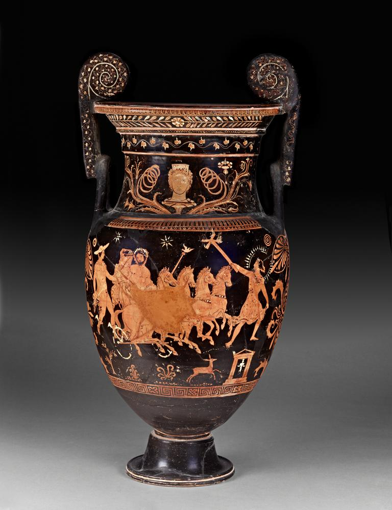 South Italian red figured pottery volute krater (bowl for mixing wine and water). Designs red on black ground, with accessories of white and yellow. On the lip, (a) above, egg-moulding; below, laurel-wreath with a rosette in the middle: (b) above, egg-moulding; below, rosettes. On the neck, (a) above the design, ivy-wreath: (b) palmettes and rosettes. Above each design, tongue- and egg-patterns; below the designs, maeander and crosses; below the handles, palmettes. On the handles in front are ivy-wreaths. On the neck, a head of Aura to the front, with curls and stephane ornamented with chevron  pattern, resting on the calyx of a flower from which luxuriant tendrils and blossoms branch out on either side; above, it is incised: AVDA, ???a. (a) Pluto carrying off Persephone: Pluto drives a chariot (turned partly to right) at full speed; he is bearded, with wreath, drapery over left arm, sceptre in left hand, with Ionic cap on which is a white eagle to right with wings spread. He turns to look at Persephone, who is at his right side, holding the frame of the chariot with left hand; her hair is gathered in a knot behind, and she wears a radiated ampyx, earrings, necklace, bracelets, long girt chiton, and embroidered himation drawn over her head as a veil with right hand. The horses have ornamented collars. On the left by the side of Persephone runs Hermes to right on slightly higher ground; he is beardless, with curly hair, petasos, bordered chlamys fastened with a fibula in front, winged endromides laced up in front, caduceus in right hand, left extended. On the right in advance of the chariot is Hecate, looking back and holding out in right hand a torch with four arms at the top, each having a flame; her hair is gathered in a bunch behind, and she wears radiated sphendone ornamented with maeander, necklace, bracelets, short embroidered chiton with girdle and cross-belt on which are white studs; behind her head is a radiated circle, partly restored. Below these figures 